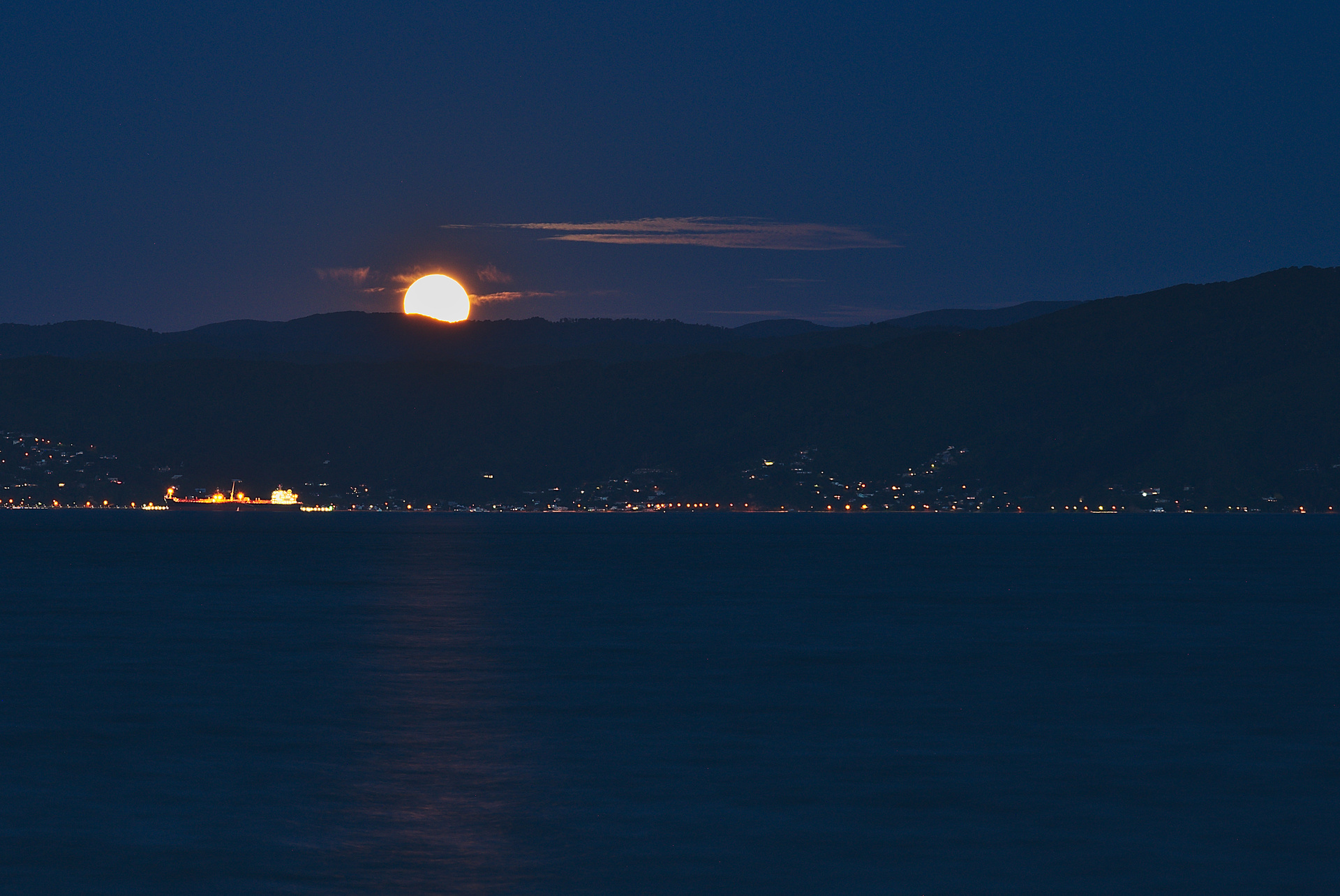At the end of the blue hour the full moon started to rise over Eastbourne